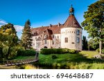 jaunpils castle is a fortified... | Shutterstock . vector #694648687