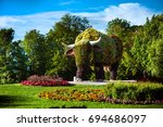 cow made from flowers in the... | Shutterstock . vector #694686097
