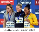 Small photo of Hong Kong, China - Oct 30, 2016. SEEBOHM Emily (AUS), OTTESEN Jeanette (DEN) and ATKINSON Alia (JAM) at the Victory Ceremony of Women's Butterfly 50m. FINA Swimming World Cup.