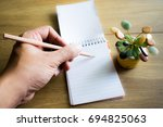 man left hand with pencil... | Shutterstock . vector #694825063