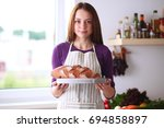 young woman holding tasty fresh ... | Shutterstock . vector #694858897