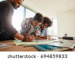 group of young business people... | Shutterstock . vector #694859833