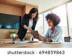 shot of business professionals... | Shutterstock . vector #694859863
