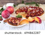 plum pie with fresh plums on a... | Shutterstock . vector #694862287