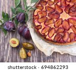plum pie with fresh plums on a... | Shutterstock . vector #694862293