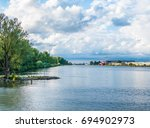 """Small photo of View of the """"Maas"""" river from the beach of a nature reserve area"""