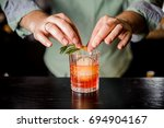 bartender decorates red... | Shutterstock . vector #694904167