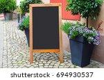 blank menu blackboard on the... | Shutterstock . vector #694930537