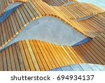 modern curved s shaped brown... | Shutterstock . vector #694934137