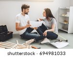young couple doing apartment... | Shutterstock . vector #694981033