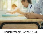 students using pen writing... | Shutterstock . vector #695014087