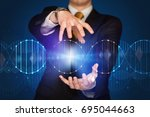 businessman with dna concept in ... | Shutterstock . vector #695044663