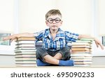 little funny boy is seating...   Shutterstock . vector #695090233