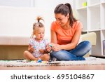 mother and daughter in their... | Shutterstock . vector #695104867