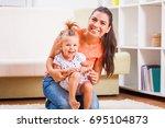 happy mother and daughter... | Shutterstock . vector #695104873