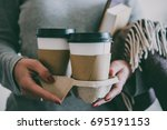 take away coffee seen in hands... | Shutterstock . vector #695191153