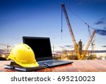 safety helmet and laptop... | Shutterstock . vector #695210023
