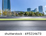 empty road with modern business ... | Shutterstock . vector #695214673