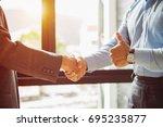 handshake for make agreement in ... | Shutterstock . vector #695235877