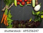 frame of organic food. fresh... | Shutterstock . vector #695256247