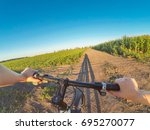 a man holds a wheel with one... | Shutterstock . vector #695270077