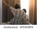 asian woman and her son easy... | Shutterstock . vector #695333893