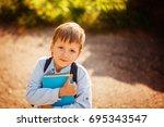 portrait little schoolboy with...   Shutterstock . vector #695343547