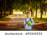 Small photo of Little boy going back to school. Child with backpack and books on first school day.