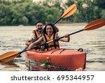 happy young couple in sea vests ...   Shutterstock . vector #695344957