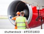 technicians in signal vests...   Shutterstock . vector #695351803