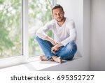 handsome thoughtful man... | Shutterstock . vector #695352727