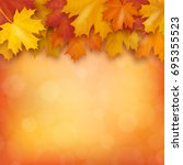 autumn maple leaves on blurry... | Shutterstock .eps vector #695355523