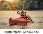 handsome young man in sea vest...   Shutterstock . vector #695361523