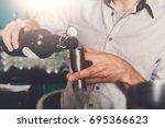 unrecognizable bartender in bar ... | Shutterstock . vector #695366623