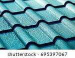 metallic roof with drops of... | Shutterstock . vector #695397067
