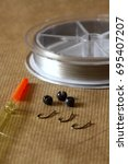 Small photo of Fishing tackle comprising of an insert waggler float barbless hooks split shot weights and monofilament line