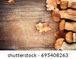 mushroom boletus over wooden... | Shutterstock . vector #695408263