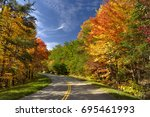 colorful leaves on foothills... | Shutterstock . vector #695461993