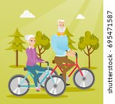 retired caucasian couple riding ... | Shutterstock .eps vector #695471587