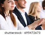 Small photo of Group of people clap their arm in row during seminar portrait. Great news, brief achievement, win deal, good job, happy birthday, employee introduce party, positive welcome, effective speech concept