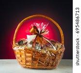 gift basket on purple background | Shutterstock . vector #695486713