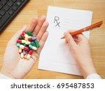 female doctor hand holding... | Shutterstock . vector #695487853