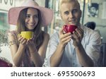 young man and woman drinking... | Shutterstock . vector #695500693