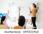 young woman teacher teaching... | Shutterstock . vector #695521963