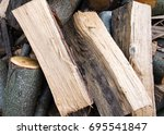pile of logs cut and chopped... | Shutterstock . vector #695541847