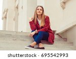 a woman student resting on the...   Shutterstock . vector #695542993
