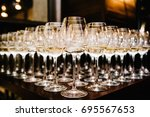 glass of white wine on a table. ...   Shutterstock . vector #695567653