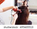 stylist align the customer's... | Shutterstock . vector #695605513