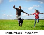 young happy pair running on... | Shutterstock . vector #69565594