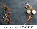various spices on vintage... | Shutterstock . vector #695663653